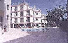 The apartments pool view in Larnaca on a quiet residential street)