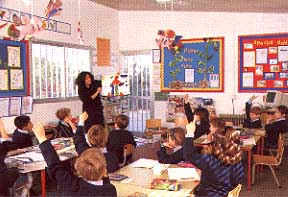 teaching the children in the classroom.JPG (22508 bytes)